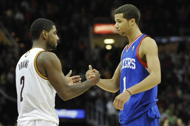 Nov 9, 2013; Cleveland, OH, USA; Cleveland Cavaliers point guard Kyrie Irving (2) and Philadelphia 76ers point guard Michael Carter-Williams (1) shake hands after a 127-125 victory by Cleveland in two overtimes at Quicken Loans Arena. Mandatory Credit: David Richard-USA TODAY Sports