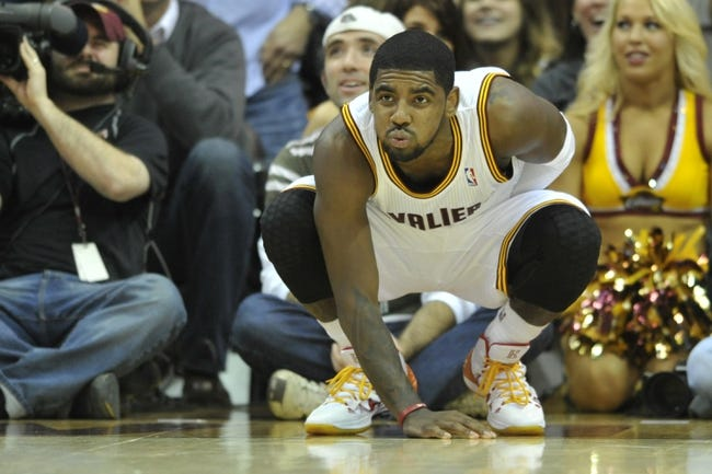 Nov 9, 2013; Cleveland, OH, USA; Cleveland Cavaliers point guard Kyrie Irving (2) reacts after missing a shot at the end of regulation against the Philadelphia 76ers at Quicken Loans Arena. Mandatory Credit: David Richard-USA TODAY Sports