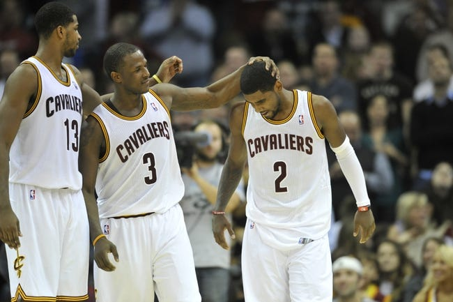 Nov 9, 2013; Cleveland, OH, USA; Cleveland Cavaliers point guard Kyrie Irving (2) is consoled by power forward Tristan Thompson (13) and shooting guard Dion Waiters (3) after missing a shot at the end of regulation against the Philadelphia 76ers at Quicken Loans Arena. Mandatory Credit: David Richard-USA TODAY Sports