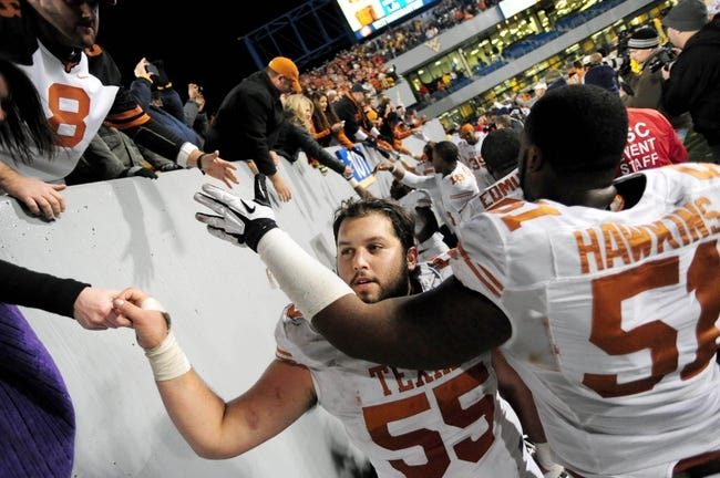 Nov 9, 2013; Morgantown, WV, USA; Texas Longhorns center Dominic Espinosa (55) high fives fans after beating the West Virginia Mountaineers 47-40 in overtime at Milan Puskar Stadium. Mandatory Credit: Evan Habeeb-USA TODAY Sports