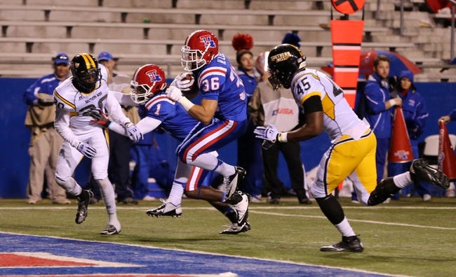 Nov 9, 2013; Ruston, LA, USA; Louisiana Tech Bulldogs running back Hunter Lee (36) scores on a 8-yard run against the Southern Miss Golden Eagles during the fourth quarter at Joe Aillet Stadium. La Tech won, 36-13. Mandatory Credit: Chuck Cook-USA TODAY Sports