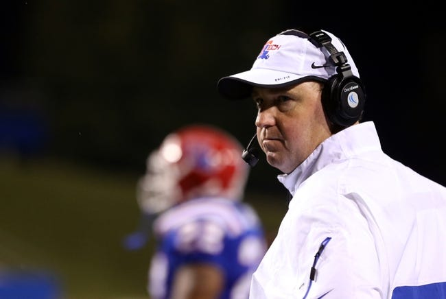 Nov 9, 2013; Ruston, LA, USA; Louisiana Tech Bulldogs head coach Skip Holtz watches his team play against the Southern Miss Golden Eagles during the second half at Joe Aillet Stadium. La Tech won, 36-13. Mandatory Credit: Chuck Cook-USA TODAY Sports