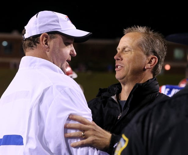 Nov 9, 2013; Ruston, LA, USA; Louisiana Tech Bulldogs head coach Skip Holtz speaks to Southern Miss Golden Eagles head coach Todd Monken at the conclusion of their game at Joe Aillet Stadium. La Tech won, 36-13. Mandatory Credit: Chuck Cook-USA TODAY Sports