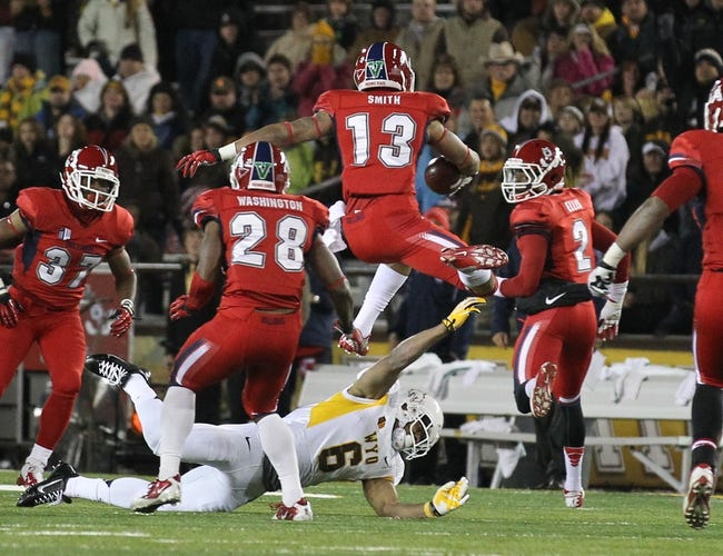 Nov 9, 2013; Laramie, WY, USA; Fresno State Bulldogs safety Derron Smith (13) runs after making an interception against the Wyoming Cowboys during the second quarter at War Memorial Stadium. Mandatory Credit: Troy Babbitt-USA TODAY Sports