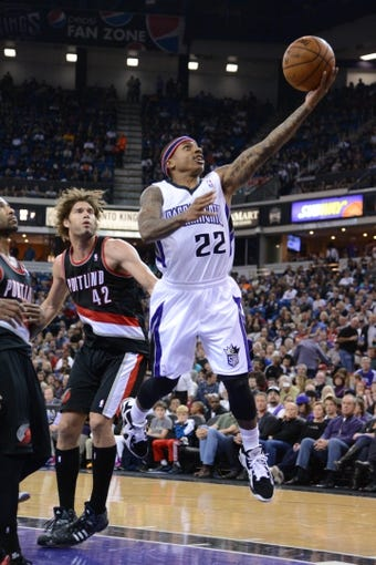 November 9, 2013; Sacramento, CA, USA; Sacramento Kings point guard Isaiah Thomas (22) drives to the basket past Portland Trail Blazers center Robin Lopez (42) during the third quarter at Sleep Train Arena. The Trail Blazers defeated the Kings 96-85. Mandatory Credit: Kyle Terada-USA TODAY Sports