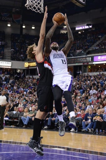 November 9, 2013; Sacramento, CA, USA; Sacramento Kings center DeMarcus Cousins (15) shoots the basketball against Portland Trail Blazers center Robin Lopez (42) during the fourth quarter at Sleep Train Arena. The Trail Blazers defeated the Kings 96-85. Mandatory Credit: Kyle Terada-USA TODAY Sports