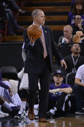 November 9, 2013; Sacramento, CA, USA; Sacramento Kings head coach Michael Malone holds the basketball against the Portland Trail Blazers during the third quarter at Sleep Train Arena. The Trail Blazers defeated the Kings 96-85. Mandatory Credit: Kyle Terada-USA TODAY Sports