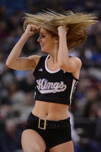 November 9, 2013; Sacramento, CA, USA; Sacramento Kings dancer performs during the first quarter against the Portland Trail Blazers at Sleep Train Arena. Mandatory Credit: Kyle Terada-USA TODAY Sports
