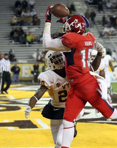 Nov 9, 2013; Laramie, WY, USA; Fresno State Bulldogs wide receiver Davante Adams (15) is unable to make a reception while defended by Wyoming Cowboys cornerback Blair Burns (20) during the fourth quarter at War Memorial Stadium. Mandatory Credit: Troy Babbitt-USA TODAY Sports