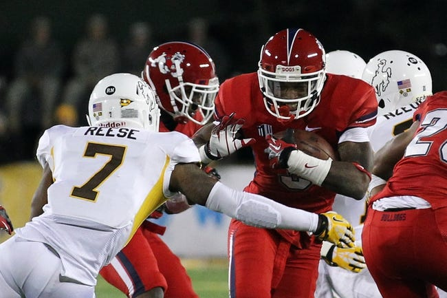 Nov 9, 2013; Laramie, WY, USA; Fresno State Bulldogs wide receiver Josh Harper (3) runs against Wyoming Cowboys safety Chad Reese (7) during the first quarter at War Memorial Stadium. The Bulldogs defeated the Cowboys 48-10. Mandatory Credit: Troy Babbitt-USA TODAY Sports