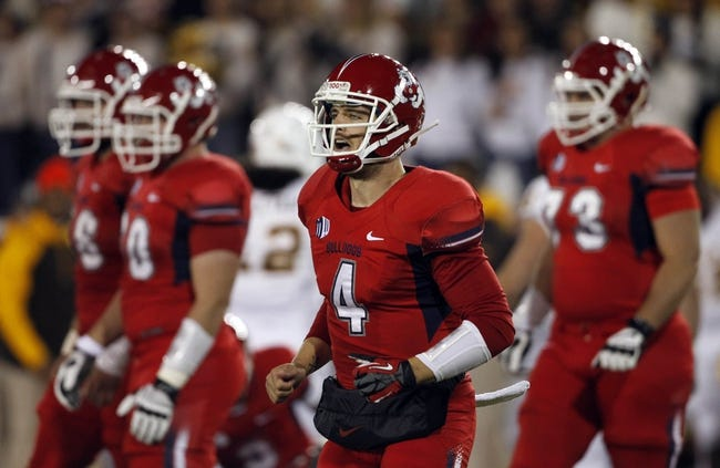Nov 9, 2013; Laramie, WY, USA; Fresno State Bulldogs quarterback Derek Carr (4) against the Wyoming Cowboys during the first quarter at War Memorial Stadium. The Bulldogs defeated the Cowboys 48-10. Mandatory Credit: Troy Babbitt-USA TODAY Sports