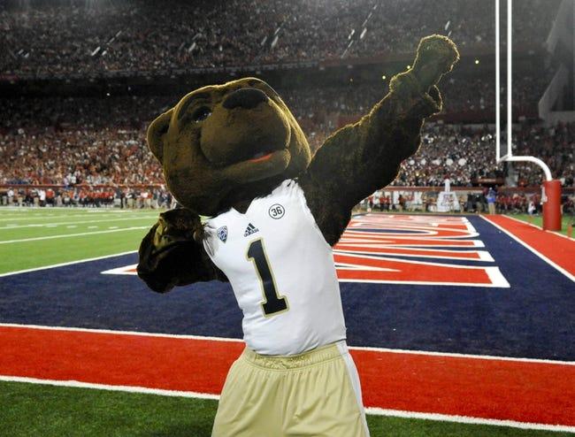 Nov 9, 2013; Tucson, AZ, USA; UCLA Bruins mascot Joe Bruin celebrates during the first quarter against the Arizona Wildcats at Arizona Stadium. UCLA beat Arizona 31-26. Mandatory Credit: Casey Sapio-USA TODAY Sports