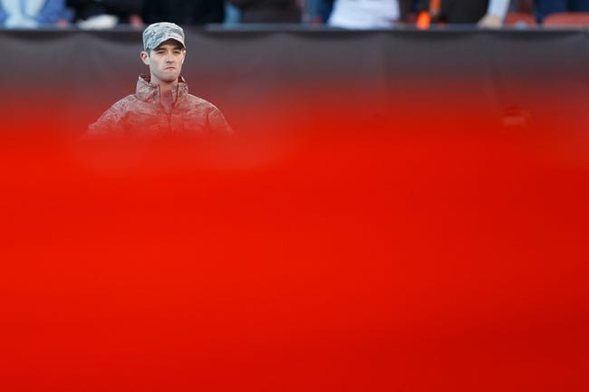 Nov 3, 2013; Cleveland, OH, USA; Military personal hold an American flag during the national anthem before the game between the Cleveland Browns and the Baltimore Ravens at FirstEnergy Stadium. Mandatory Credit: Rick Osentoski-USA TODAY Sports