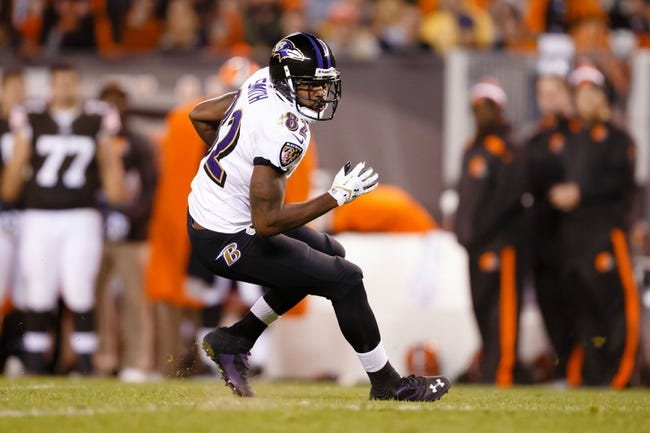 Nov 3, 2013; Cleveland, OH, USA; Baltimore Ravens wide receiver Torrey Smith (82) runs the ball against the Cleveland Browns at FirstEnergy Stadium. Mandatory Credit: Rick Osentoski-USA TODAY Sports