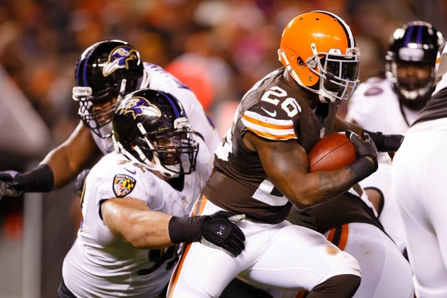 Nov 3, 2013; Cleveland, OH, USA; Cleveland Browns running back Willis McGahee (26) runs the ball as Baltimore Ravens nose tackle Haloti Ngata (92) wraps him up in the second half at FirstEnergy Stadium. Mandatory Credit: Rick Osentoski-USA TODAY Sports