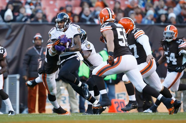 Nov 3, 2013; Cleveland, OH, USA; Baltimore Ravens wide receiver Tandon Doss (17) runs the ball against the Cleveland Browns at FirstEnergy Stadium. Mandatory Credit: Rick Osentoski-USA TODAY Sports