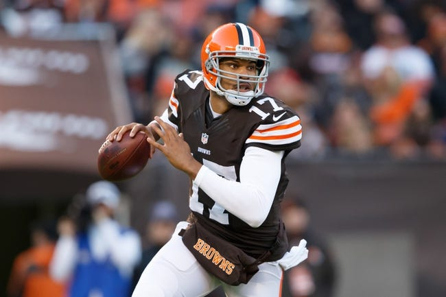 Nov 3, 2013; Cleveland, OH, USA; Cleveland Browns quarterback Jason Campbell (17) rolls out to pass against the Baltimore Ravens at FirstEnergy Stadium. Mandatory Credit: Rick Osentoski-USA TODAY Sports