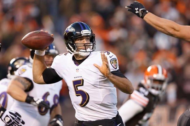 Nov 3, 2013; Cleveland, OH, USA; Baltimore Ravens quarterback Joe Flacco (5) looks to pass against the Cleveland Browns at FirstEnergy Stadium. Mandatory Credit: Rick Osentoski-USA TODAY Sports
