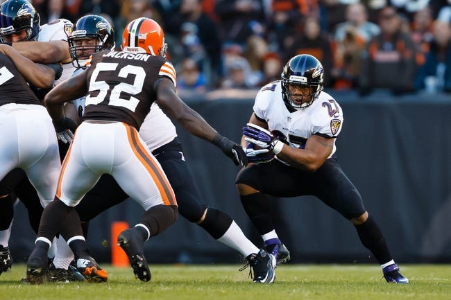 Nov 3, 2013; Cleveland, OH, USA; Baltimore Ravens running back Ray Rice (27) runs the ball defended by Cleveland Browns inside linebacker D'Qwell Jackson (52) at FirstEnergy Stadium. Mandatory Credit: Rick Osentoski-USA TODAY Sports