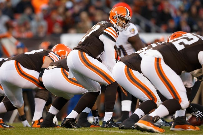 Nov 3, 2013; Cleveland, OH, USA; Cleveland Browns quarterback Jason Campbell (17) gets set to run a play against the Baltimore Ravens at FirstEnergy Stadium. Mandatory Credit: Rick Osentoski-USA TODAY Sports