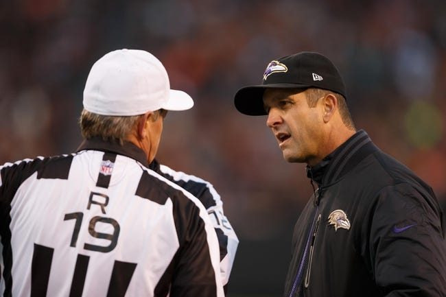 Nov 3, 2013; Cleveland, OH, USA; Baltimore Ravens head coach John Harbaugh talks to referee Scott Green (19) during the game against the Cleveland Browns at FirstEnergy Stadium. Mandatory Credit: Rick Osentoski-USA TODAY Sports