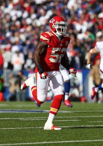 Nov 3, 2013; Orchard Park, NY, USA; Kansas City Chiefs linebacker James-Michael Johnson (52) against the Buffalo Bills at Ralph Wilson Stadium. Mandatory Credit: Timothy T. Ludwig-USA TODAY Sports