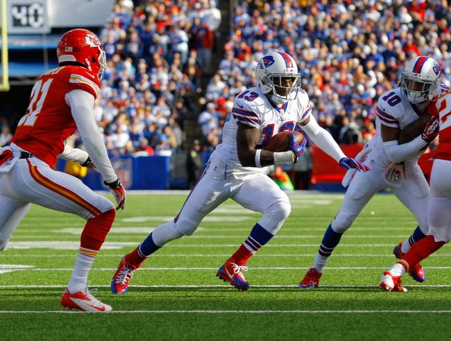 Nov 3, 2013; Orchard Park, NY, USA; Buffalo Bills wide receiver Steve Johnson (13) runs the ball after a catch against the Kansas City Chiefs at Ralph Wilson Stadium. Mandatory Credit: Timothy T. Ludwig-USA TODAY Sports