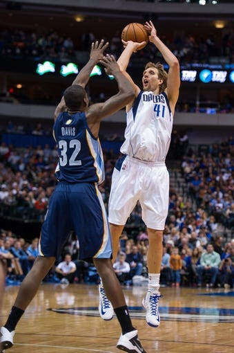 Nov 2, 2013; Dallas, TX, USA; Dallas Mavericks power forward Dirk Nowitzki (41) shoots over Memphis Grizzlies power forward Ed Davis (32) during the game at the American Airlines Center. The Mavericks defeated the Grizzlies 111-99. Mandatory Credit: Jerome Miron-USA TODAY Sports