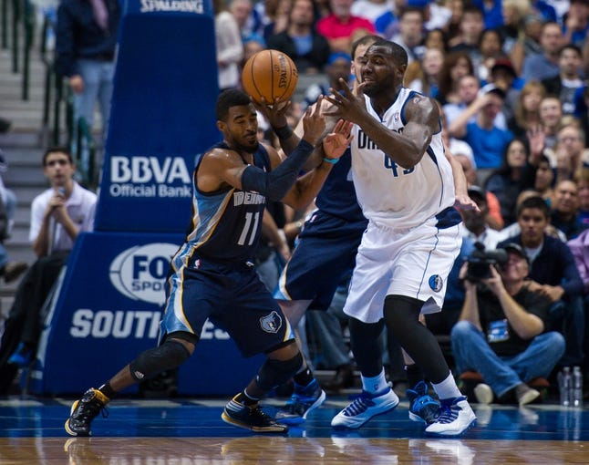 Nov 2, 2013; Dallas, TX, USA; Dallas Mavericks center DeJuan Blair (45) and Memphis Grizzlies point guard Mike Conley (11) fight for the ball during the game at the American Airlines Center. The Mavericks defeated the Grizzlies 111-99. Mandatory Credit: Jerome Miron-USA TODAY Sports