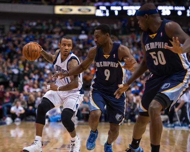 Nov 2, 2013; Dallas, TX, USA; Memphis Grizzlies shooting guard Tony Allen (9) and power forward Zach Randolph (50) guard Dallas Mavericks shooting guard Monta Ellis (11) during the game at the American Airlines Center. The Mavericks defeated the Grizzlies 111-99. Mandatory Credit: Jerome Miron-USA TODAY Sports
