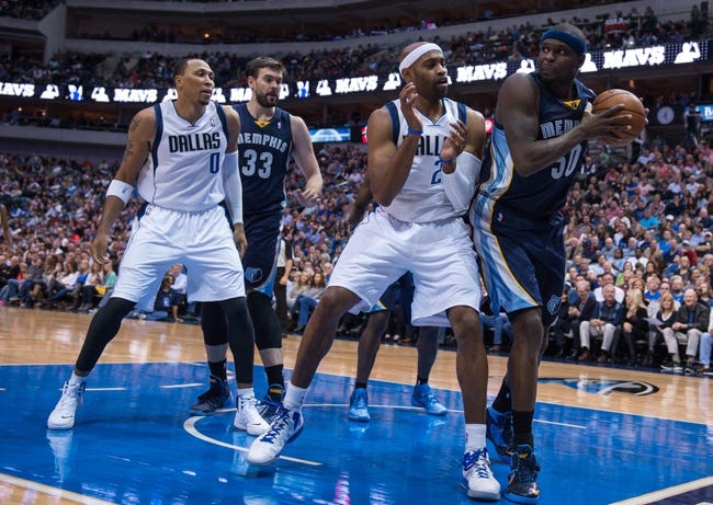 Nov 2, 2013; Dallas, TX, USA; Memphis Grizzlies power forward Zach Randolph (50) grabs a rebound in front of Dallas Mavericks shooting guard Vince Carter (25) during the game at the American Airlines Center. The Mavericks defeated the Grizzlies 111-99. Mandatory Credit: Jerome Miron-USA TODAY Sports