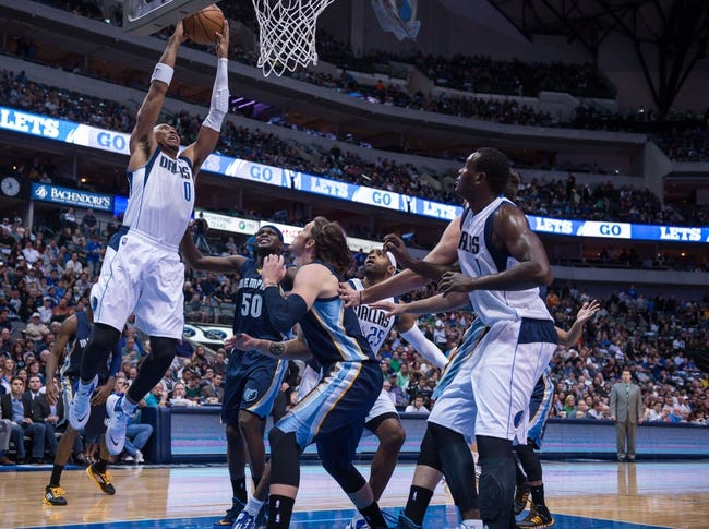 Nov 2, 2013; Dallas, TX, USA; Dallas Mavericks small forward Shawn Marion (0) dunks the ball over Memphis Grizzlies power forward Zach Randolph (50) and small forward Mike Miller (13) during the game at the American Airlines Center. The Mavericks defeated the Grizzlies 111-99. Mandatory Credit: Jerome Miron-USA TODAY Sports