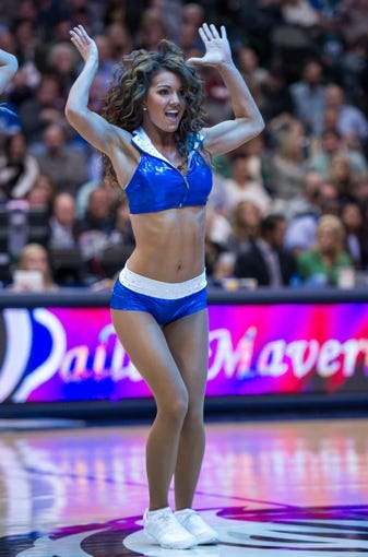 Nov 2, 2013; Dallas, TX, USA; The Dallas Mavericks dancers perform during the game between the Mavericks and the Memphis Grizzlies at the American Airlines Center. The Mavericks defeated the Grizzlies 111-99. Mandatory Credit: Jerome Miron-USA TODAY Sports