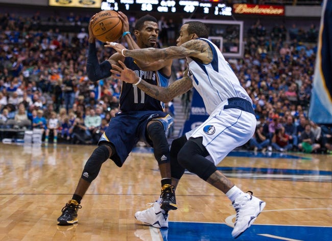 Nov 2, 2013; Dallas, TX, USA; Dallas Mavericks shooting guard Monta Ellis (11) guards Memphis Grizzlies point guard Mike Conley (11) during the game at the American Airlines Center. The Mavericks defeated the Grizzlies 111-99. Mandatory Credit: Jerome Miron-USA TODAY Sports