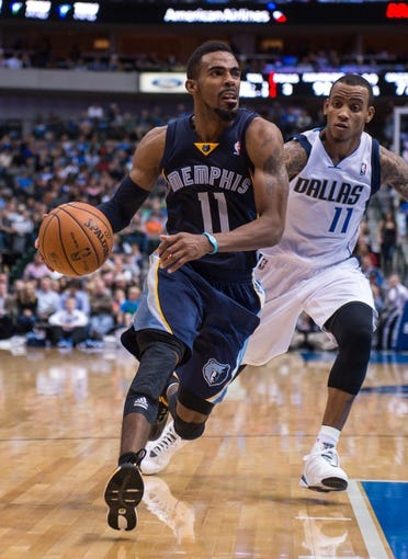 Nov 2, 2013; Dallas, TX, USA; Memphis Grizzlies point guard Mike Conley (11) drives to the basket past Dallas Mavericks shooting guard Monta Ellis (11) during the game at the American Airlines Center. The Mavericks defeated the Grizzlies 111-99. Mandatory Credit: Jerome Miron-USA TODAY Sports