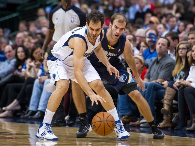 Nov 2, 2013; Dallas, TX, USA; Memphis Grizzlies shooting guard Nick Calathes (12) guards Dallas Mavericks point guard Jose Calderon (8) during the game at the American Airlines Center. The Mavericks defeated the Grizzlies 111-99. Mandatory Credit: Jerome Miron-USA TODAY Sports