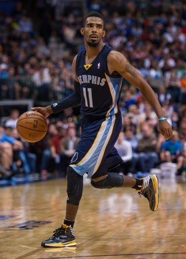 Nov 2, 2013; Dallas, TX, USA; Memphis Grizzlies point guard Mike Conley (11) dribbles the ball against the Dallas Mavericks during the game at the American Airlines Center. The Mavericks defeated the Grizzlies 111-99. Mandatory Credit: Jerome Miron-USA TODAY Sports