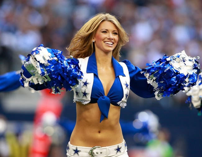 Nov 3, 2013; Arlington, TX, USA; Dallas Cowboys cheerleader performs during the game against the Minnesota Vikings  at AT&T Stadium. Dallas beat Minnesota 27-23. Mandatory Credit: Tim Heitman-USA TODAY Sports