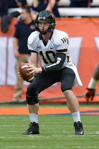 Nov 2, 2013; Syracuse, NY, USA; Wake Forest Demon Deacons quarterback Tanner Price (10) receives the snap of the ball in the first quarter of a game against the Syracuse Orange at the Carrier Dome. Mandatory Credit: Mark Konezny-USA TODAY Sports