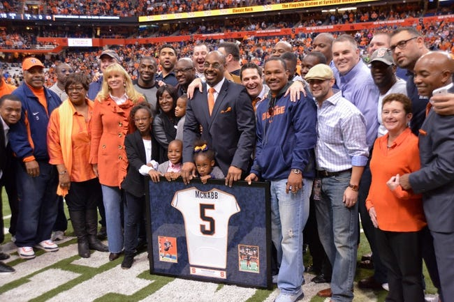 Nov 2, 2013; Syracuse, NY, USA; Syracuse Orange former quarterback Donovan McNabb with family and friends after having his jersey retired during halftime of a game against the Wake Forest Demon Deacons at the Carrier Dome. Mandatory Credit: Mark Konezny-USA TODAY Sports