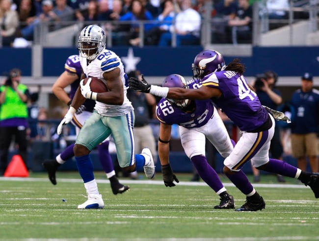 Nov 3, 2013; Arlington, TX, USA; Dallas Cowboys wide receiver Dez Bryant (88) avoids the tackle of Minnesota Vikings strong safety Mistral Raymond (41) during the game at AT&T Stadium. Dallas beat Minnesota 27-23. Mandatory Credit: Tim Heitman-USA TODAY Sports
