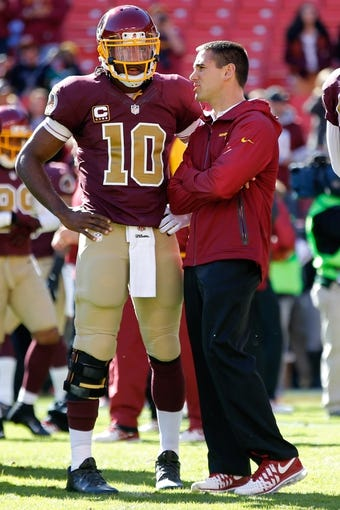 Nov 3, 2013; Landover, MD, USA; Washington Redskins quarterback Robert Griffin III (10) talks with Redskins quarterbacks coach Mike Nolan prior to the Redskins' game against the San Diego Chargers at FedEx Field. The Redskins won 30--24 in overtime. Mandatory Credit: Geoff Burke-USA TODAY Sports