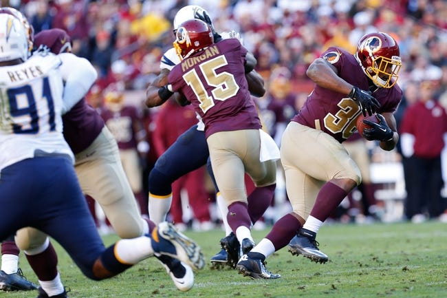 Nov 3, 2013; Landover, MD, USA; Washington Redskins fullback Darrel Young (36) carries the ball against the San Diego Chargers in the second quarter at FedEx Field. Mandatory Credit: Geoff Burke-USA TODAY Sports