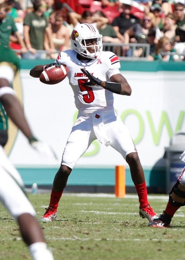 Oct 26, 2013; Tampa, FL, USA; Louisville Cardinals quarterback Teddy Bridgewater (5) throws the ball against the South Florida Bulls during the first half at Raymond James Stadium. Mandatory Credit: Kim Klement-USA TODAY Sports
