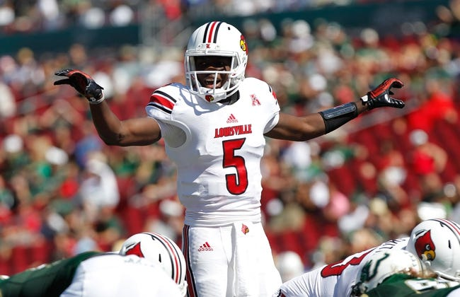 Oct 26, 2013; Tampa, FL, USA; Louisville Cardinals quarterback Teddy Bridgewater (5) calls a play against the South Florida Bulls during the first half at Raymond James Stadium. Mandatory Credit: Kim Klement-USA TODAY Sports