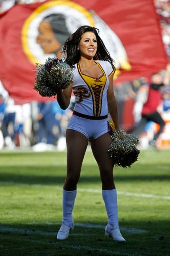 Nov 3, 2013; Landover, MD, USA; A Washington Redskins cheerleader dances on the field against the San Diego Chargers at FedEx Field. The Redskins won 30--24 in overtime. Mandatory Credit: Geoff Burke-USA TODAY Sports