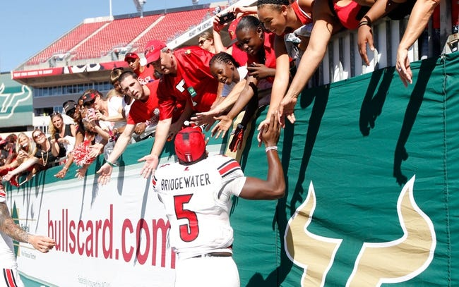 Oct 26, 2013; Tampa, FL, USA; Louisville Cardinals quarterback Teddy Bridgewater (5) high fives fans against the South Florida Bulls after the game at Raymond James Stadium. Mandatory Credit: Kim Klement-USA TODAY Sports