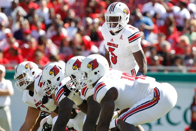 Oct 26, 2013; Tampa, FL, USA; Louisville Cardinals quarterback Teddy Bridgewater (5) calls a play at the line of scrimmage against the South Florida Bulls during the first quarter  at Raymond James Stadium. Mandatory Credit: Kim Klement-USA TODAY Sports