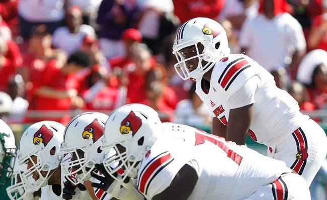 Oct 26, 2013; Tampa, FL, USA; Louisville Cardinals quarterback Teddy Bridgewater (5) against the South Florida Bulls during the first quarter  at Raymond James Stadium. Mandatory Credit: Kim Klement-USA TODAY Sports