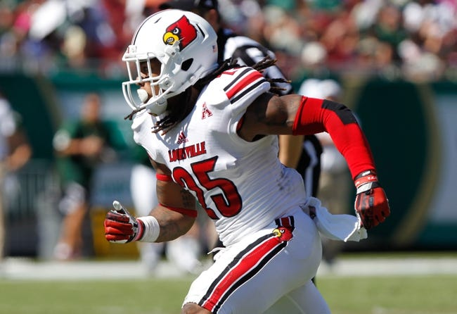 Oct 26, 2013; Tampa, FL, USA; Louisville Cardinals safety Calvin Pryor (25) rushes against the South Florida Bulls during the second half at Raymond James Stadium. Mandatory Credit: Kim Klement-USA TODAY Sports